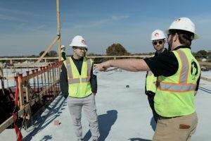 Licensed contractors discussing a job site