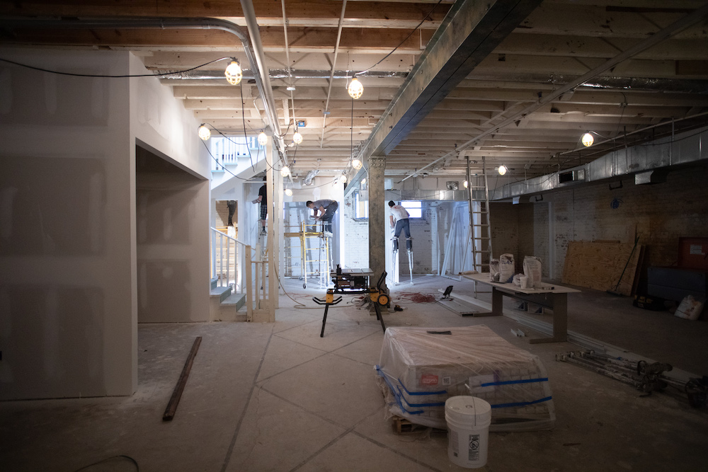 Work lights strung in a construction site | Cash Flow Problems in Construction