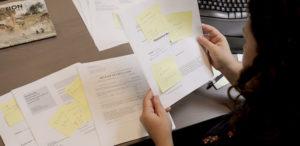 Office manager reviews mechanics lien documents